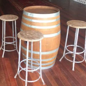 Wine barrel and rustic stools
